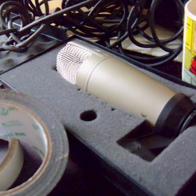 Gaffer tape, microphone and mug of tea.